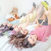 iStockGirls_Together_On_Bed1—02