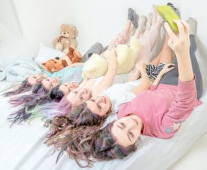 Girls lying on a bed at pamper party